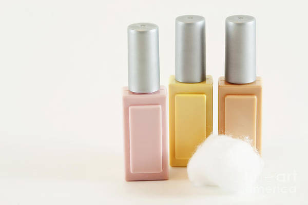 Wall Art - Photograph - Three Makeup Bottles by Blink Images