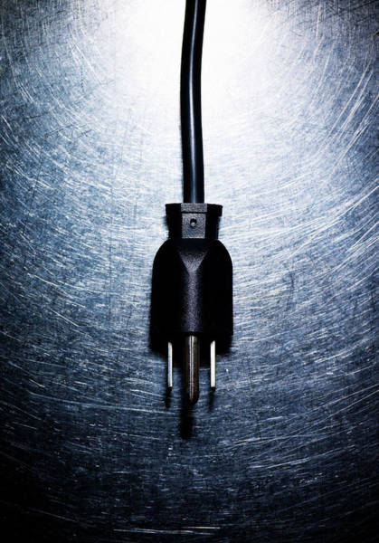 Wall Art - Photograph - Three-pronged Electrical Plug On Stainless Steel. by Ballyscanlon
