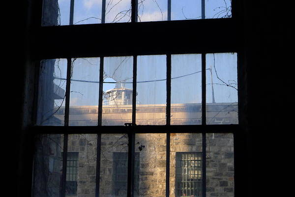 Photograph - Through The Bars by Richard Reeve