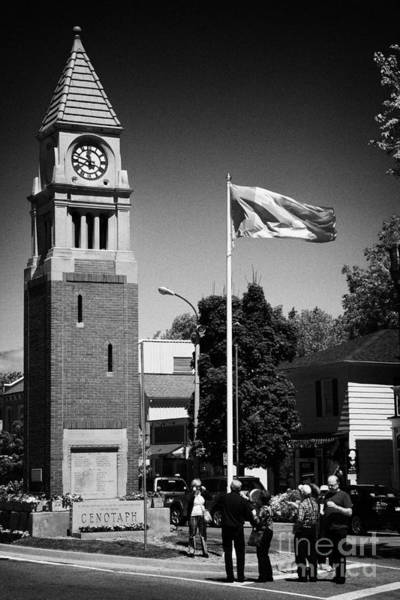 Flying The Flag Wall Art - Photograph - Tourists At The Cenotaph Clock Tower Niagara-on-the-lake Ontario Canada by Joe Fox