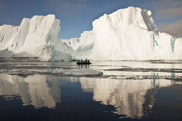 Photograph - Tourists In Zodiac Looking At Iceberg by Colin Monteath