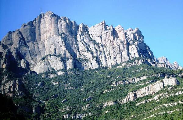 Photograph - Towards Montserrat Monastery Close Up Mountain View Blue Sky Near Barcelona Spain by John Shiron