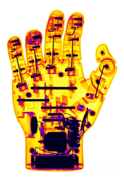 Photograph - Toy Robotic Hand X-ray by Ted Kinsman