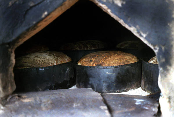 Photograph - Traditional Bread In Oven by Emanuel Tanjala