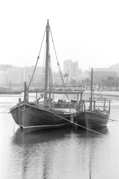 Photograph - Traditional Dhows In Doha Bay by Paul Cowan