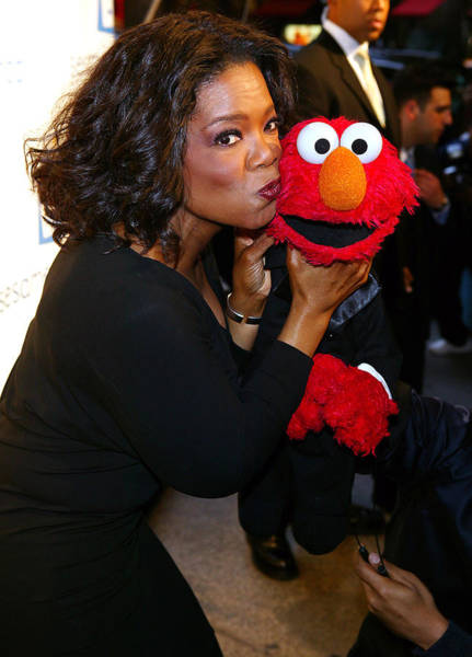 Oprah Wall Art - Photograph - Tv Host Oprah Winfrey And Friend Elmo by Everett