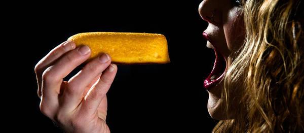 Lip Piercing Wall Art - Photograph - Twinkie Bite by Scott Sawyer