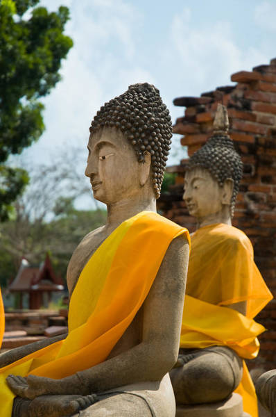 Photograph - Two Buddha Statues Wrapped In An Orange Scarf  by U Schade