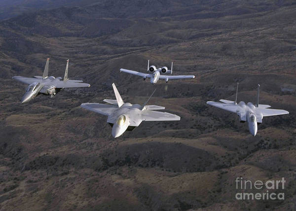 Photograph - Two F-15 Eagles Fly Alongside An F-22a by Stocktrek Images