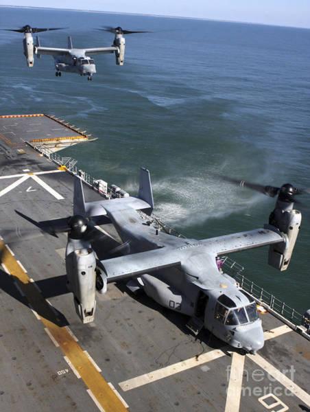 Mv-22 Photograph - Two Mv-22 Ospreys Land On The Flight by Stocktrek Images