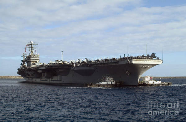 Uss Carl Vinson Photograph - Two Tug Boats Help To Move The Aircraft by Stocktrek Images