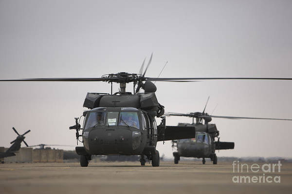 Utility Helicopter Photograph - Two Uh-60 Black Hawks Taxi by Terry Moore