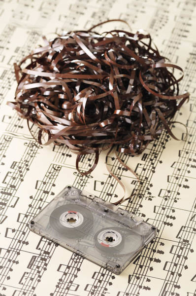 Messier Object Photograph - Unravelled Cassette Tape On Sheet Music by Jean-Christophe Riou