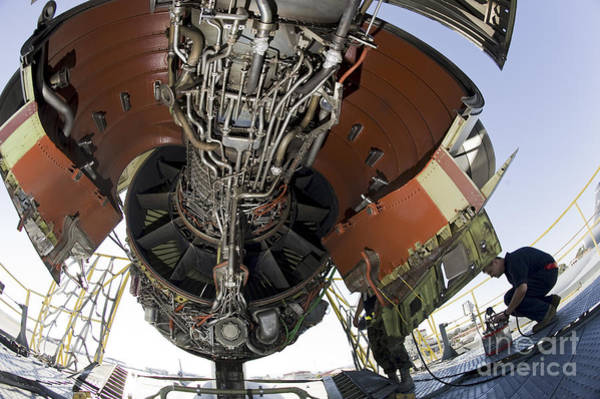 Airbase Photograph - U.s. Air Force Technician Hydraulically by Stocktrek Images
