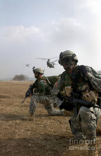 Photograph - U.s. Army Sergeants Secure A Helicopter by Stocktrek Images