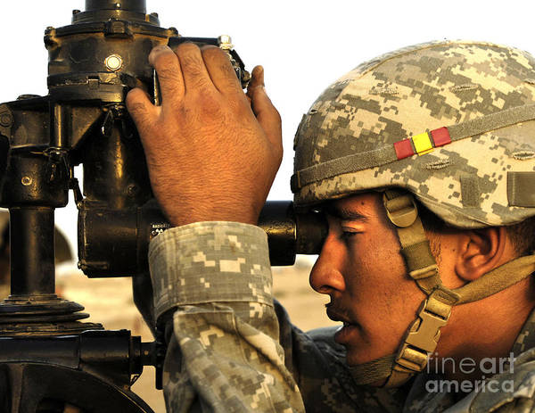 Photograph - U.s. Army Soldier Looks Through A Gun by Stocktrek Images