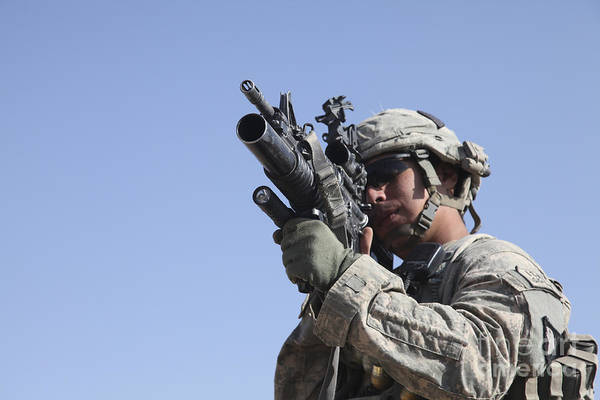 Grenade Launcher Wall Art - Photograph - U.s. Army Soldier Scans The Area by Stocktrek Images