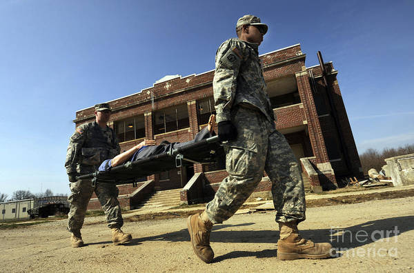Photograph - U.s Army Soldiers Transport A Manikin by Stocktrek Images