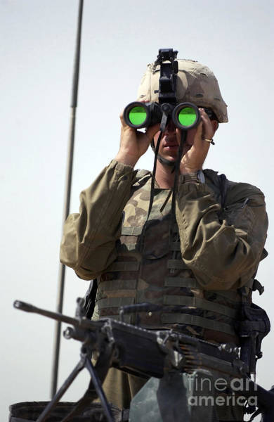 Photograph - U.s. Army Specialist Uses Binoculars by Stocktrek Images