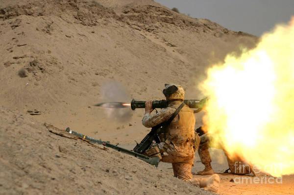 Gunfire Photograph - U.s. Marine Fires An M136 At4 Light by Stocktrek Images