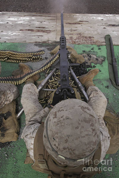 Gunfire Photograph - U.s. Marine Fires An M2 .50-caliber by Stocktrek Images