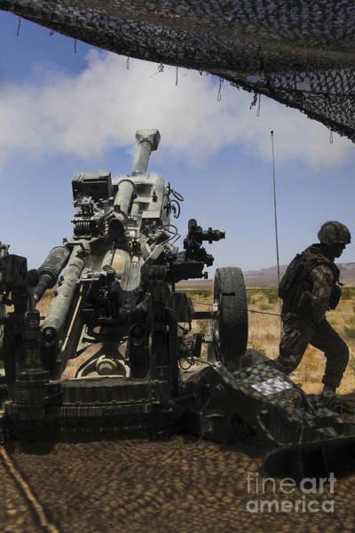 Gunfire Photograph - U.s. Marines Fire An M777 Howitzer by Stocktrek Images