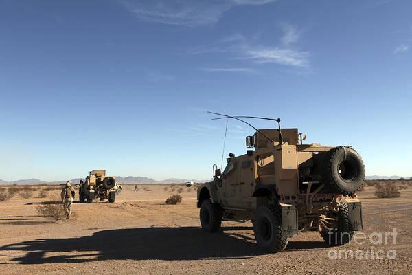 Atv Photograph - U.s. Marines Guide M-atvs by Stocktrek Images