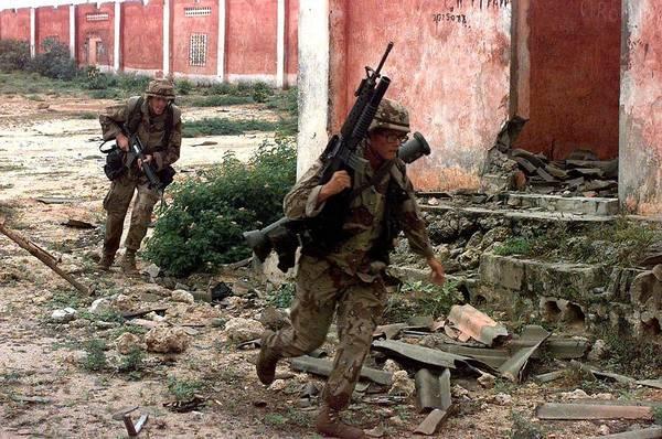 Mogadishu Wall Art - Photograph - U.s. Marines Running From Sniper Fire by Everett