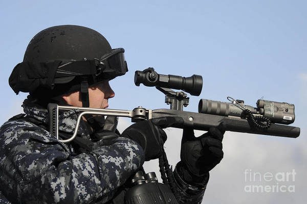 Laser Gun Photograph - U.s. Navy Chief Uses An La9p Nonlethal by Stocktrek Images
