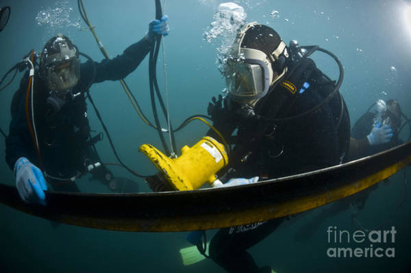 Photograph - U.s. Navy Diver Instructs A Barbados by Stocktrek Images