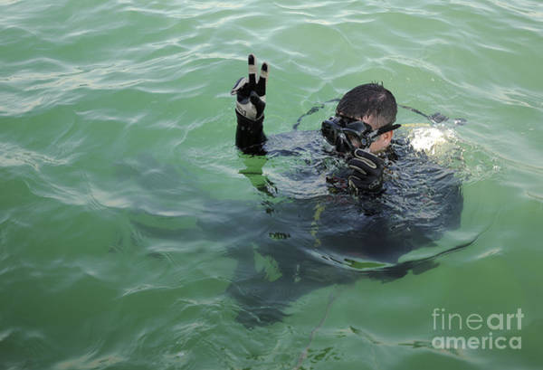 Bahrain Photograph - U.s. Navy Diver Signals Before Diving by Stocktrek Images