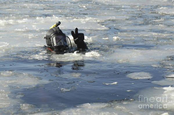 Photograph - U.s. Navy Diver Signals He Is Okay by Stocktrek Images