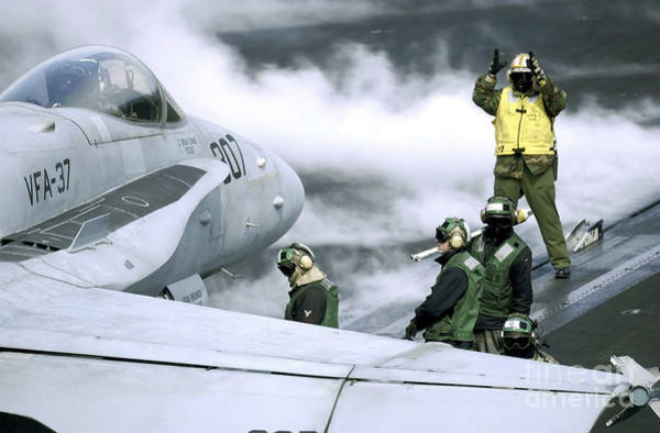 Photograph - U.s. Navy Sailors Position A Fa-18c by Stocktrek Images