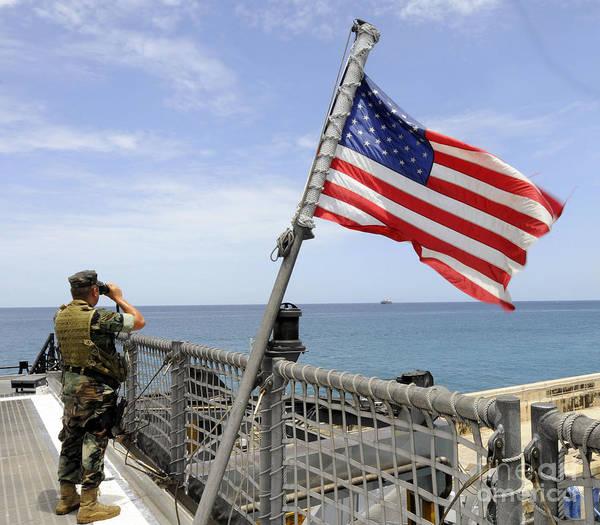 Photograph - U.s. Navy Seaman Stands Watch by Stocktrek Images