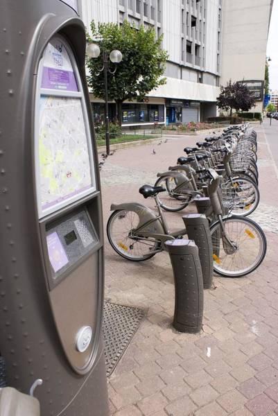 Bicycle Rack Photograph - Velib Bike Rental In Paris by Mark Williamson