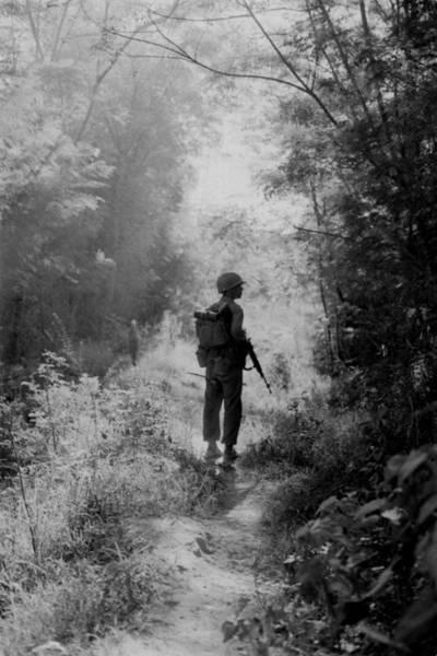 Quang Nam Province Photograph - Vietnam War. A Us Marine Walking Point by Everett
