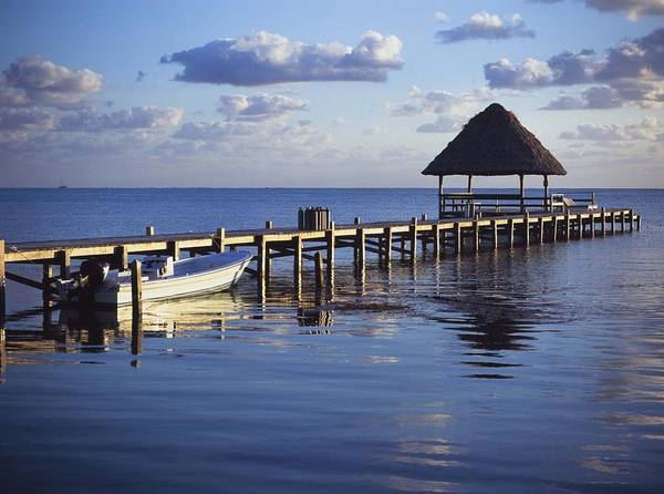 Ambergris Caye Photograph - View Of The Pier Across The Water At by Axiom Photographic
