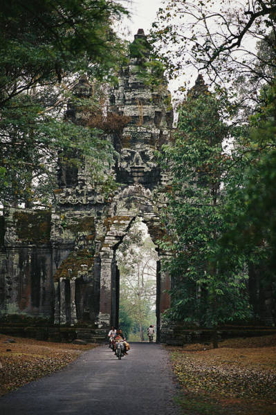 Wall Art - Photograph - Visitors Enter The Angkor Wat Complex by Steve Raymer