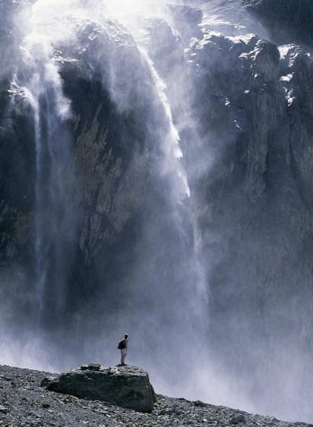 Walker Beneath Waterfall In The Cirque Art Print