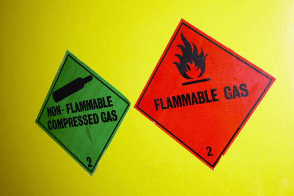 Flammable Wall Art - Photograph - Warning Signs by Colin Cuthbert