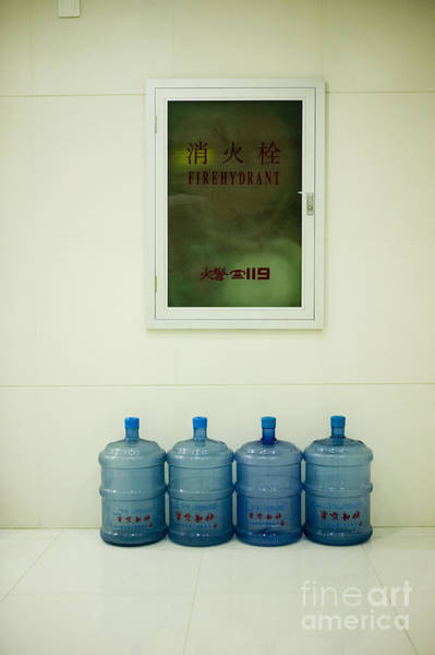 Water Hydrant Photograph - Water Cooler Bottles And Fire Hydrant Cabinet by Andersen Ross