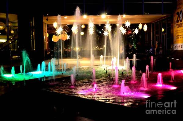 Photograph - Water Fountain With Stars And Blue Green With Pink Lights by Christopher Shellhammer
