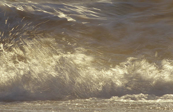 Turmoil Photograph - Waves Breaking Onto A Beach Turn Golden by Jason Edwards