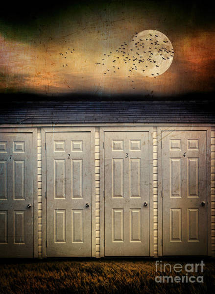 Photograph - White Shed Doors With Storm Looming In Background by Sandra Cunningham
