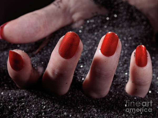 Burried Photograph - Woman Hand With Red Nail Polish Buried In Black Sand by Oleksiy Maksymenko