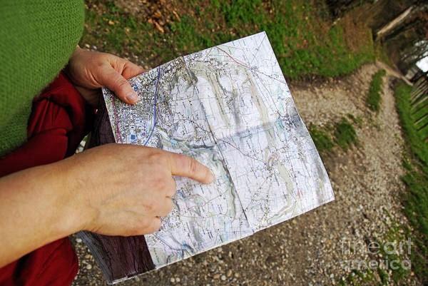 Road Map Photograph - Woman On Country Road Pointing Map by Sami Sarkis
