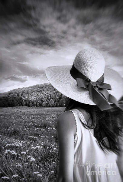 Photograph - Woman Staning With Sun Hat In A Meadow Of Flowers by Sandra Cunningham