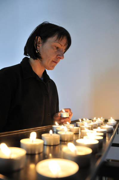 Singly Photograph - Woman With Candles In Church by Matthias Hauser