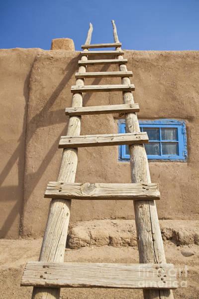 Rungs Wall Art - Photograph - Wooden Ladder Against An Adobe Building by Bryan Mullennix