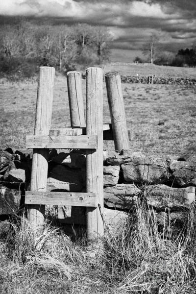 Boundary County Photograph - Wooden Style Across A Dry Stone Wall In A Field In Rural Ireland by Joe Fox